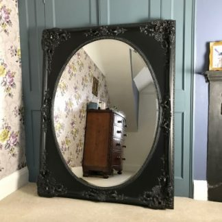 Black oval mirror 36x48